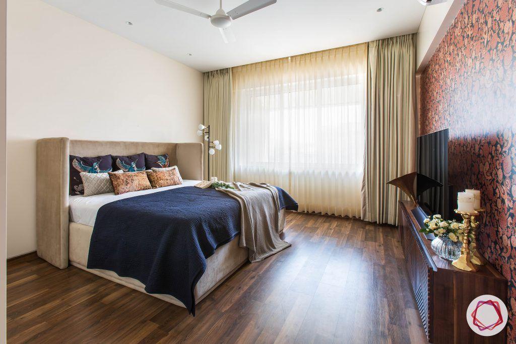 4bhk house plan-guest room designs-upholstered bed-floral wallpaper-wooden flooring