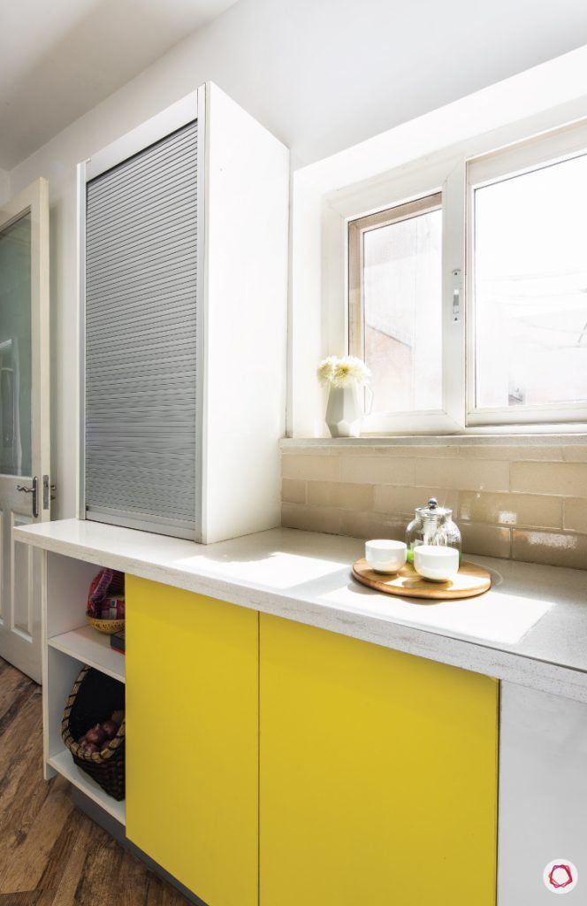 flat-in-faridabad-kitchen-roller-shutter-yellow-lower-cabinets-ceramic-tiles