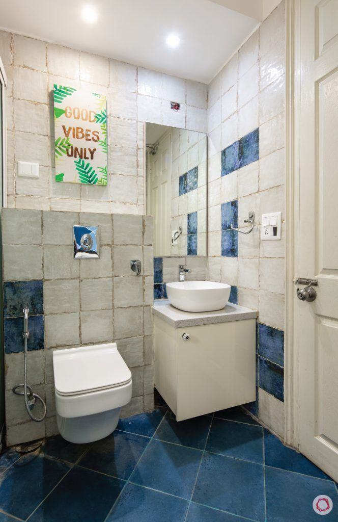 flat-in-faridabad-bathroom-blue-white-tiles-vanity-mirror-sink-cabinet