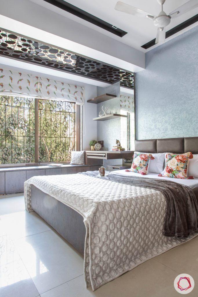 master bedroom-stylish room-dark colours-big window-window seating