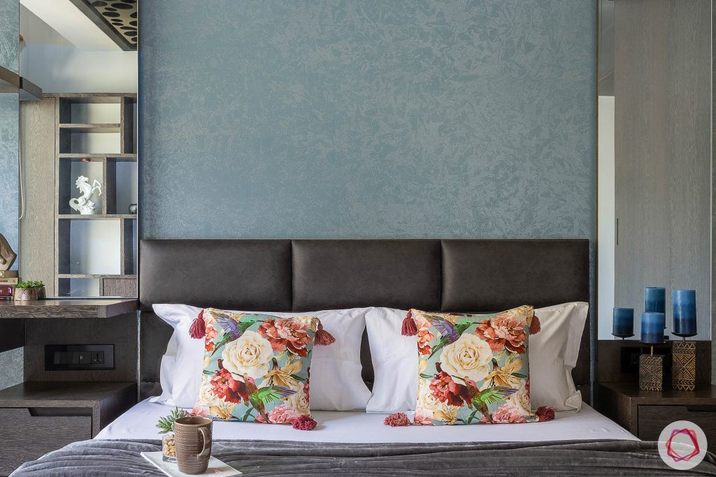 master bedroom-bed-upholstered headboard-texture wall paint