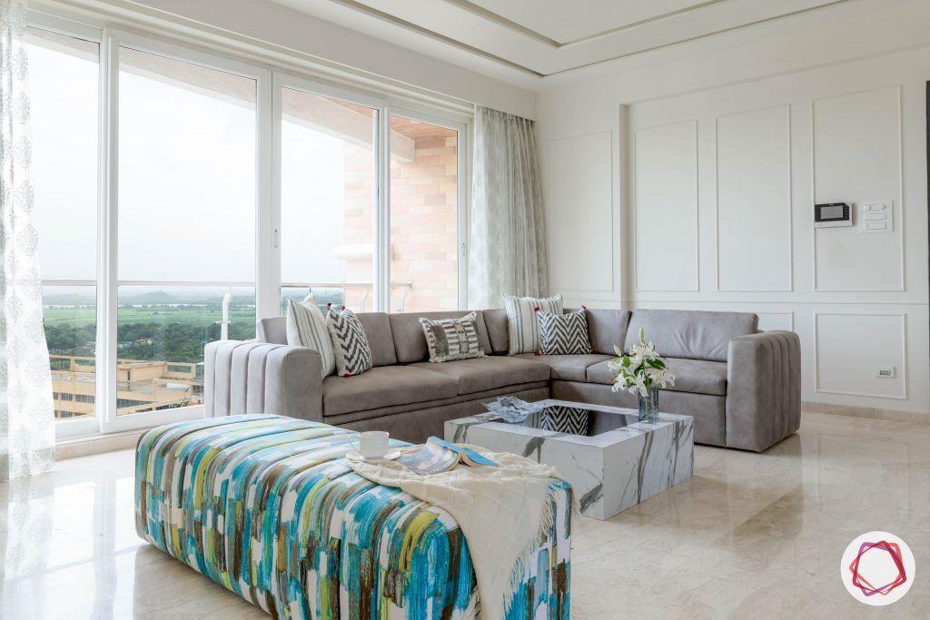 interior-design-questions-grey-sofa-marble-coffee-table-white-walls-balcony