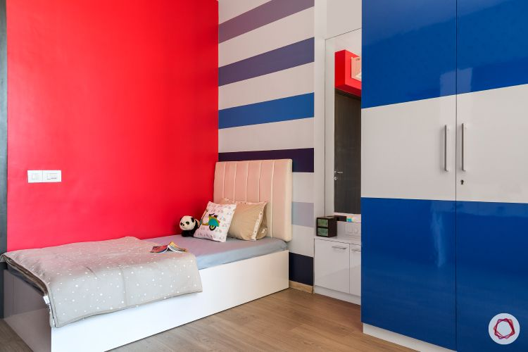 kids room-bright colours-red wall-striped wall-blue wardrobe