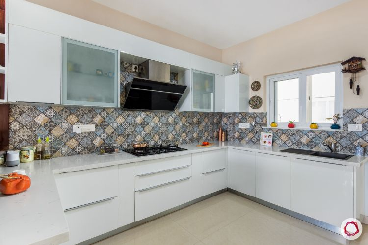 white kitchen-moroccan tiles-ducted chimney