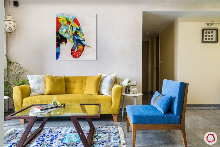 living-room-yellow-sofa-blue-chair-blue-rug-wooden-glass-table