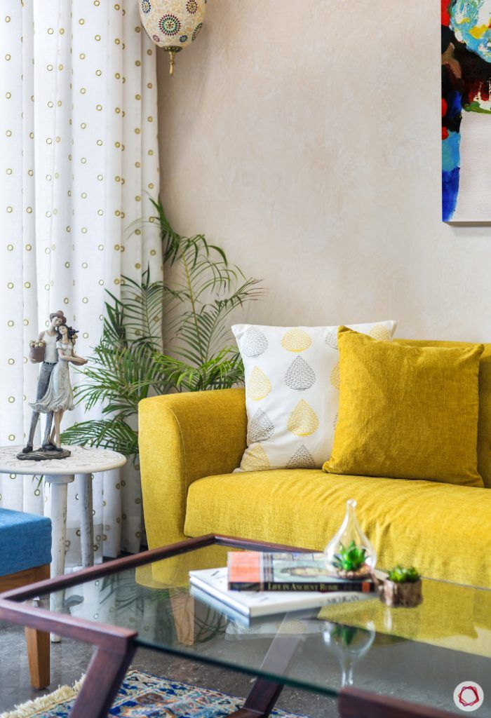 living-room-corner-sofa-yellow-accent-light-side-table-showpiece