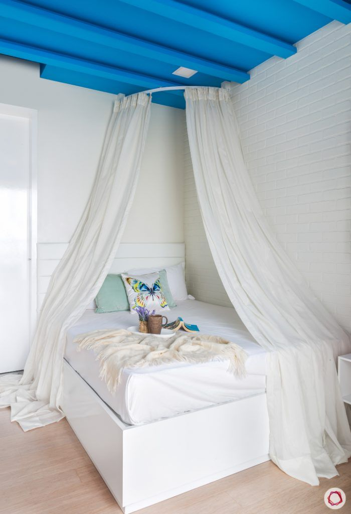 daughter-bedroom-white-bed-drapes-blue-rafters