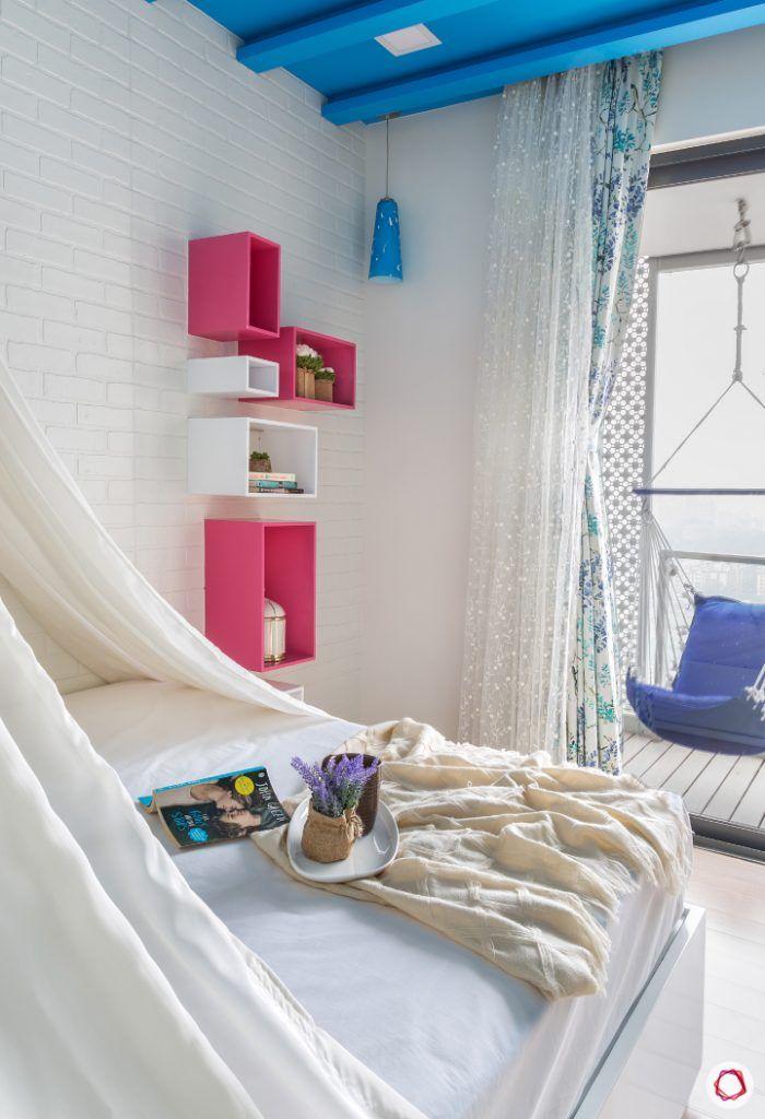lodha-wadala-daughter-bedroom-white-wall-blue-ceiling-pink-shelves-swing