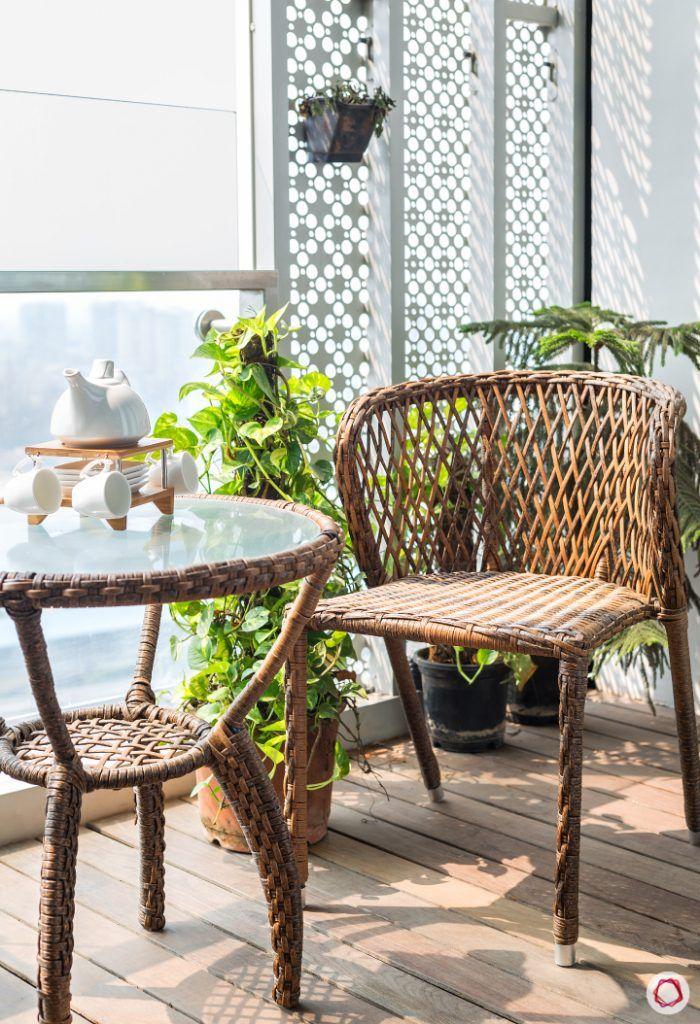 lodha-wadala-balcony-chair-table-plants-white-divider-flooring