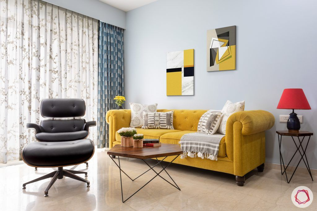 crescent bay-living room-yellow sofa-blue wall-wooden furniture
