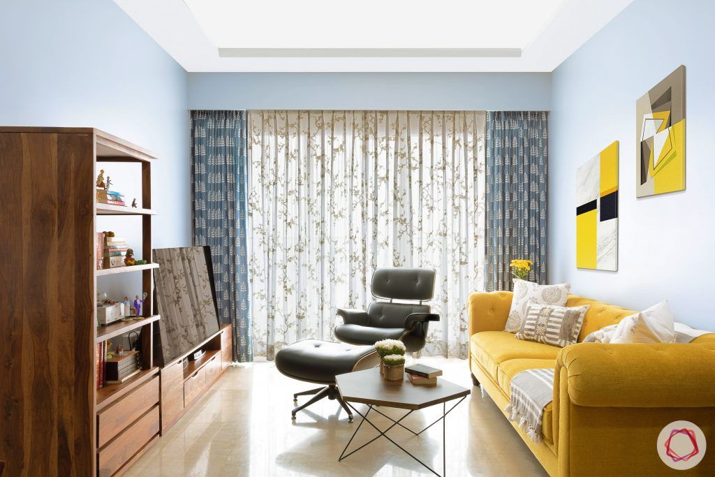 crescent bay-living room-yellow sofa-wooden tv unit-drapes-curtains