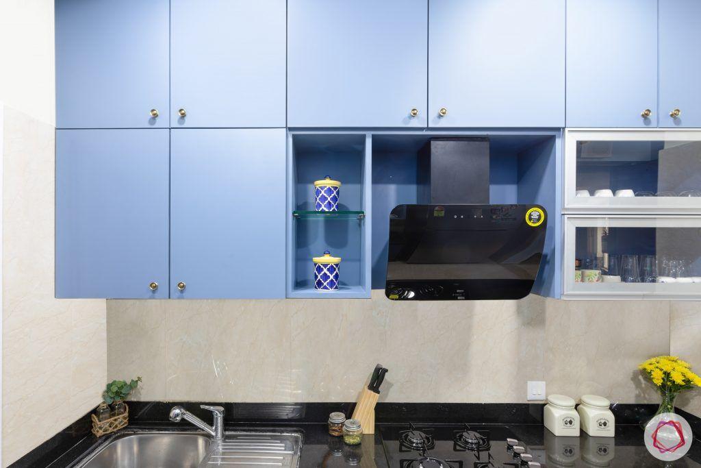 crescent bay-modular kitchen-chimney-blue cabinets-shelves