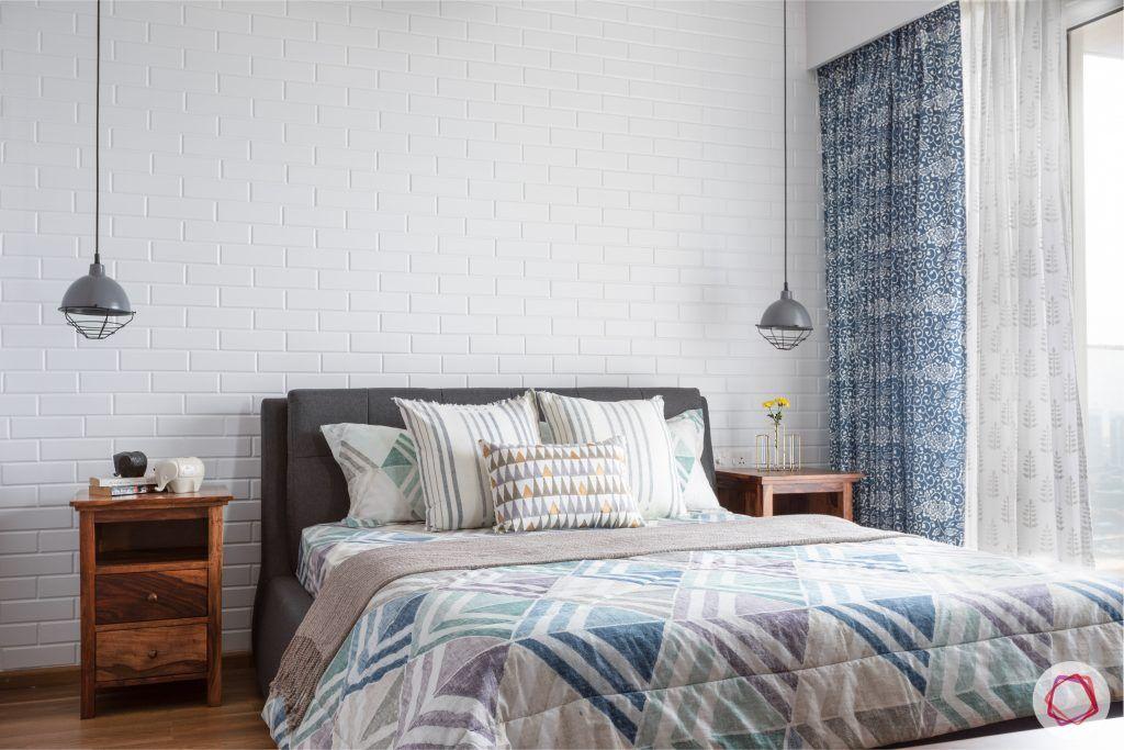 crescent bay-master bedroom-wooden side tables-upholstered bed-pendant lights