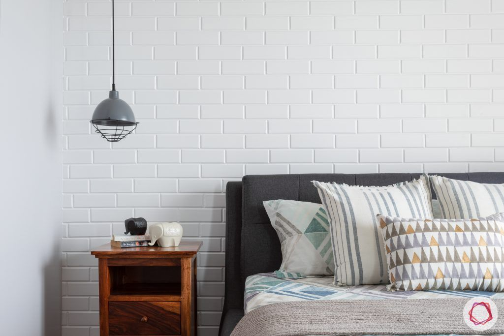 crescent bay-master bedroom-wooden side table-mesh pendant light-exposed brick wall
