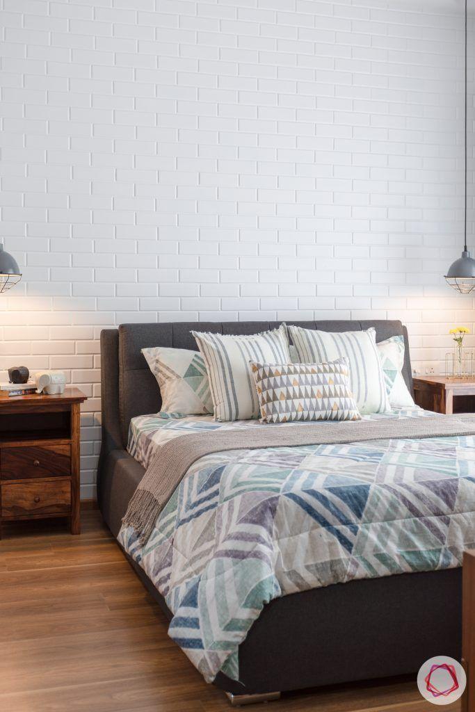 crescent bay-master bedroom-pendant lights-wooden flooring-exposed brick wall