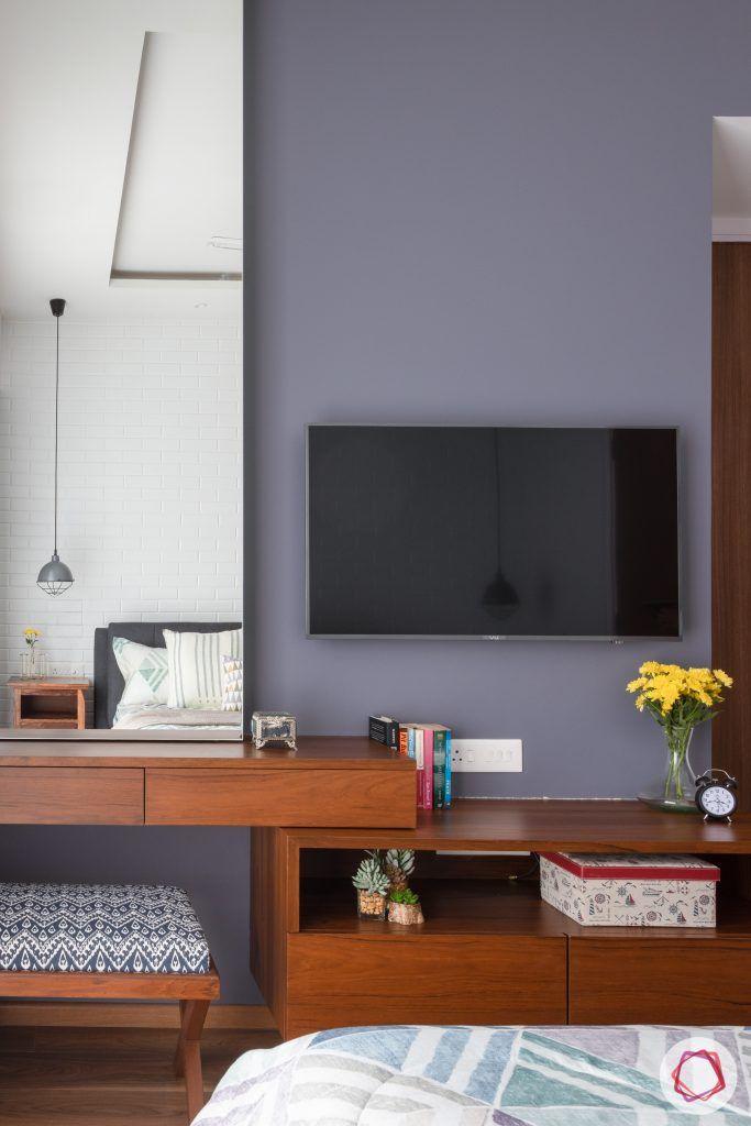 crescent bay-master bedroom-wooden flooring-tv unit-grey wall