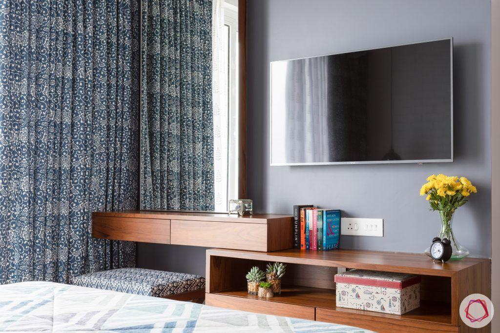 crescent bay-master bedroom-wooden flooring-tv unit-grey wall-dresser