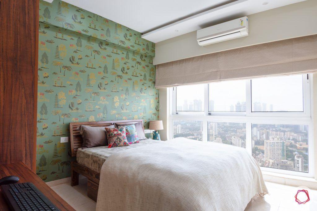 crescent bay-guest bedroom-green wallpaper-windows-blinds
