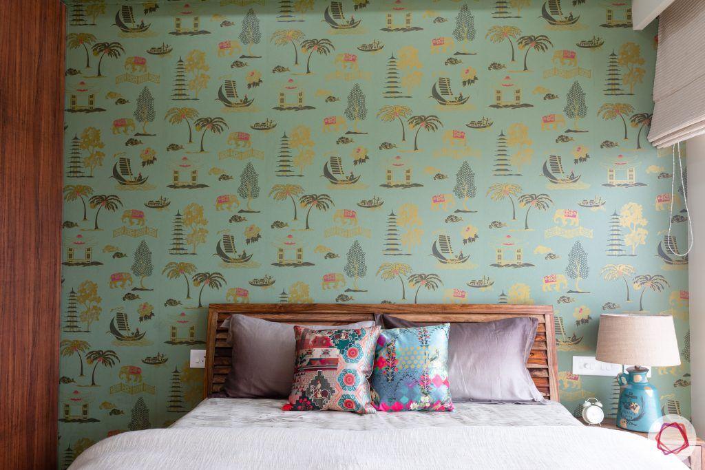 crescent bay-guest bedroom-green wallpaper-wooden bed