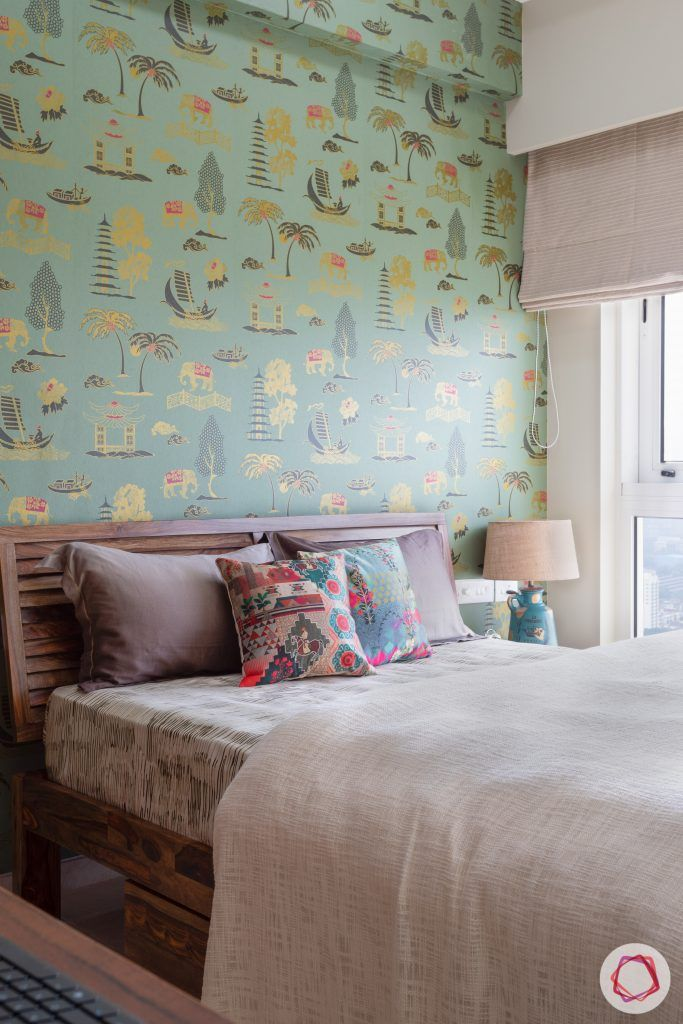 crescent bay-guest bedroom-green wallpaper-wooden bed-bedside lamp