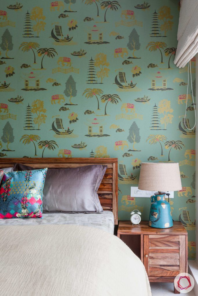 crescent bay-guest bedroom-green wallpaper-wooden bed-bedside lamp-printed wallpaper