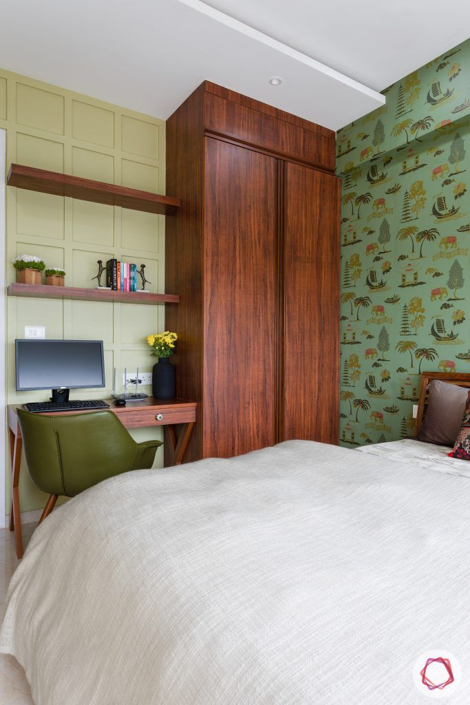 crescent bay-guest bedroom-green wallpaper-study table-wall mouldings-wooden shelves