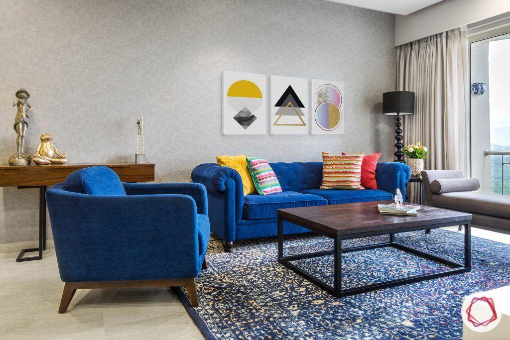 lodha group-living room designs-blue sofa designs-persian rug designs
