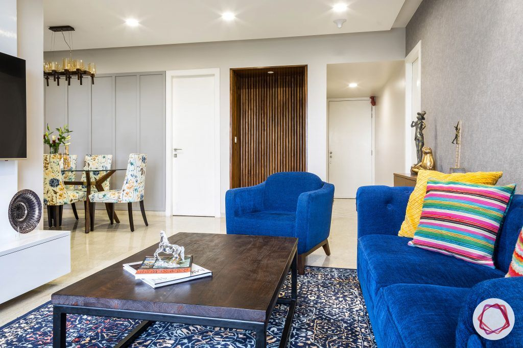 lodha group-living room designs-blue sofa designs-persian rug designs-veneer centre table