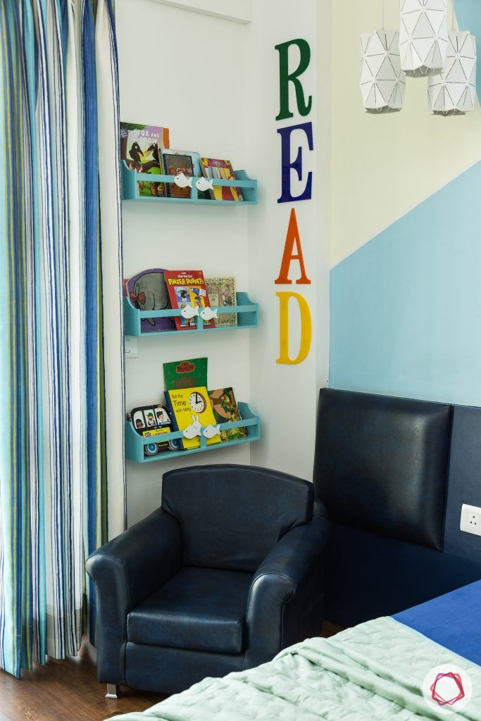 kids-room-reading-nook-black-sofa-bookshelf-blue-wall