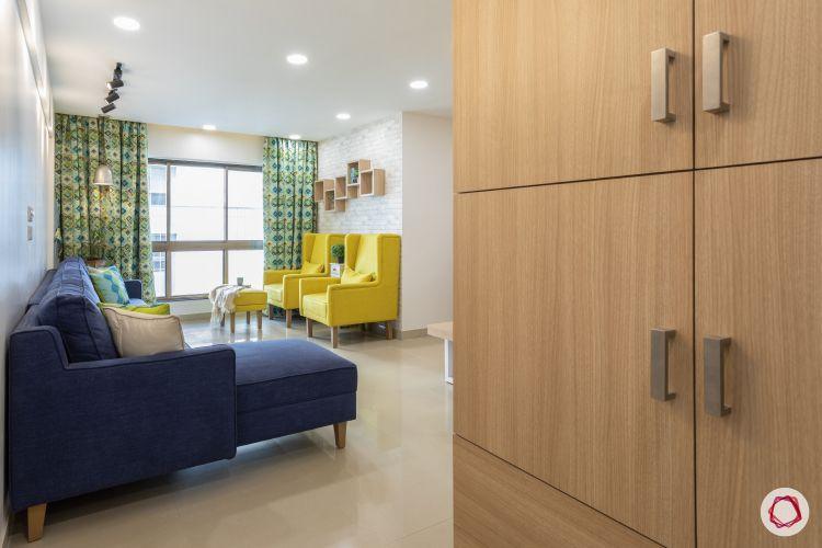 godrej homes-mumbai home-living room-entrance-blue sofa-big living room
