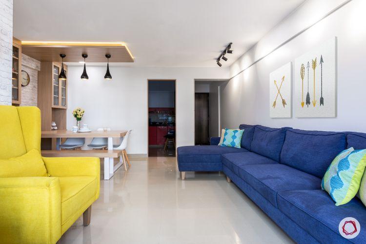 godrej homes-mumbai home-living room-white wall-track lights-blue sofa-led strip light