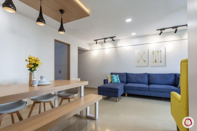 godrej homes-mumbai home-dining room-LED strip light-wooden dining table-pendant lights-bench