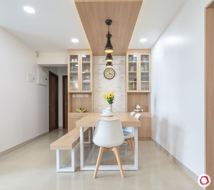 godrej homes-mumbai home-dining room-pendant lights-crockery unit-laminate finish dining table