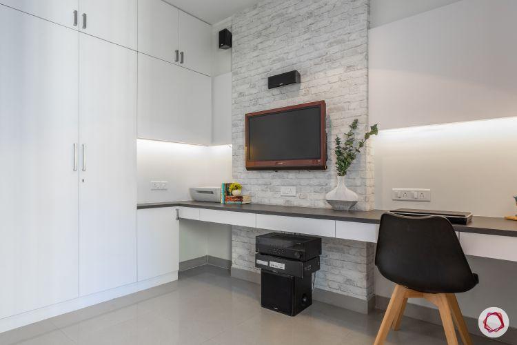 godrej homes-mumbai home-entertainment room-study table-exposed brick wallpaper-laminate wardrobes