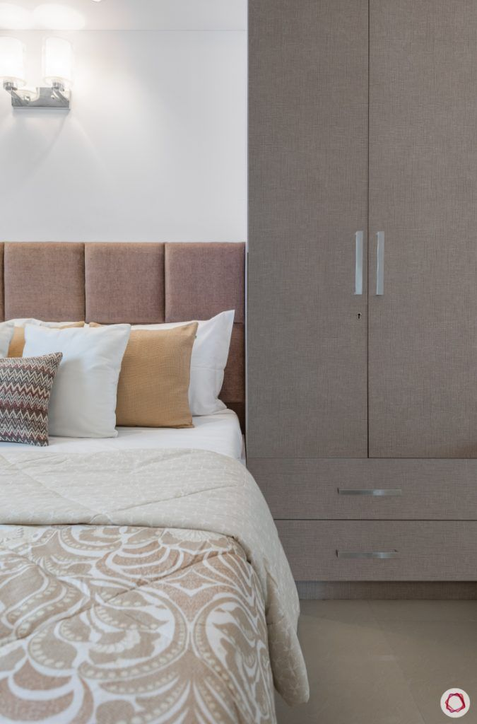 godrej homes-mumbai home-master bedroom-bed-wall sconces-upholstered headboard
