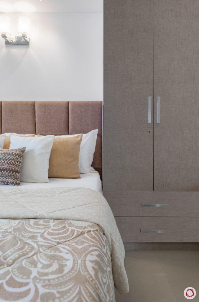 godrej homes-mumbai home-master bedroom-bed-wall sconces-upholstered headboard