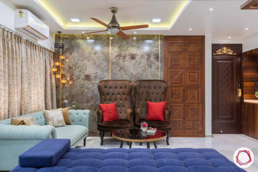 residential-interior-designers-in-mumbai-living-room-sofa-brown-blue-tiles