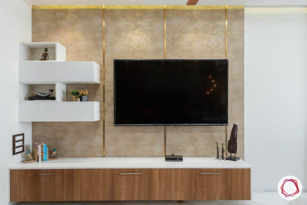 residential-interior-designers-in-mumbai-living-room-TV-wallpaper-gold-subtle