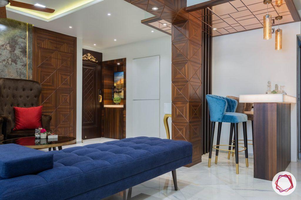 residential-interior-designers-in-mumbai-bar-blue-stool-mirror-light-table