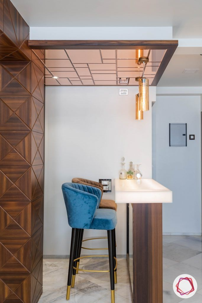 residential-interior-designers-in-mumbai-bar-blue-stool-mirror-light-table-gold
