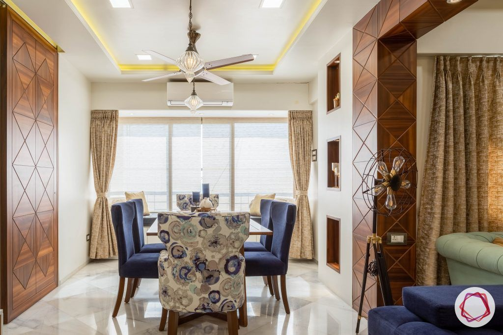 residential-interior-designers-in-mumbai-dining-room-table-chairs-lamp-light
