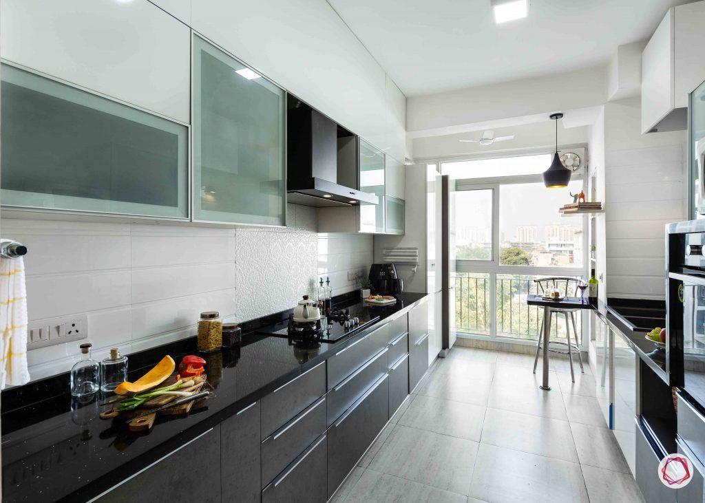 small kitchen design-grey-white-cabinets-breakfast-table-black-counter