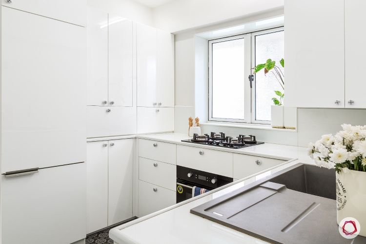 small kitchen design-white-upper-lower-cabinets-counter-sink-hob-window