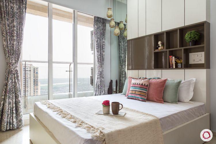 best interior designers in mumbai-guest room-balcony-white bed