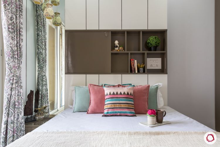 best interior designers in mumbai-guest room-headboard niche-display shelves-white bed