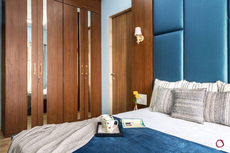 best interior designers in mumbai-parents room-laminate wardrobe-mirror panel-swing door wardrobe
