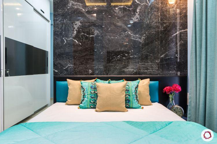best interior designers in mumbai-bedroom-marble tiles-black tiles-sliding wardrobe-bed