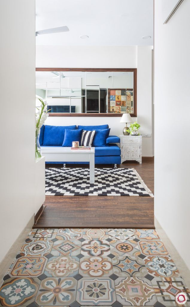 passage-sofa-rug-white-table-mirror-wooden-floor