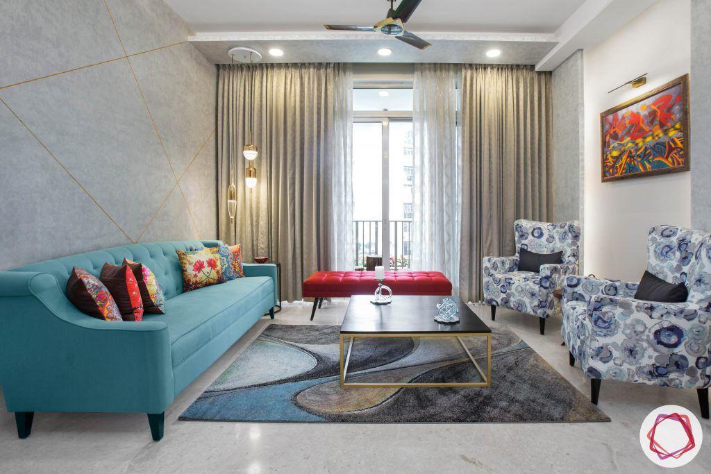 best interior designers in gurgaon-armchair designs-blue sofa designs-red ottoman designs