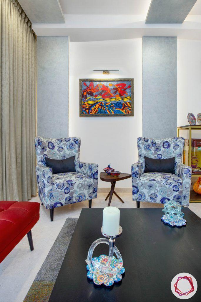 best interior designers in gurgaon-armchair designs-red ottoman designs
